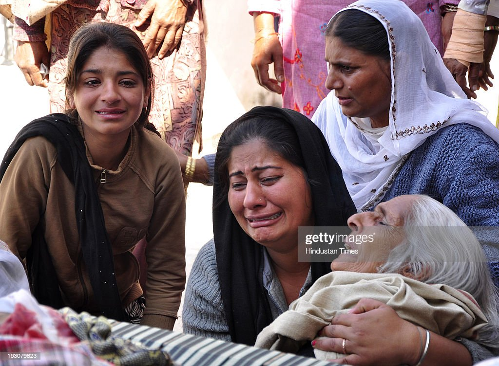 Wailing relatives holding the grandmother of Sukhman and Jaskaran who died after their school bus collided with a truck laden with bricks on March 4, 2013 in Jalandhar, India. Atleast Twelve children and their driver were reportedly killed in the accident near Jaheera village in Lambhra, close to Nakodar town in the morning.