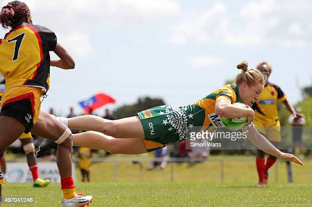 Wairakau Greig of the Cook Islands dives in for a try during the World Sevens Oceania Olympic Qualification match between Papua New Guinea and the...