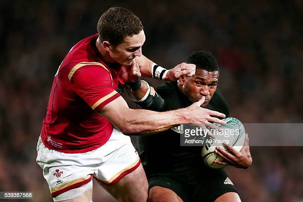 Waisake Naholo of New Zealand fends against George North of Wales during the International Test match between the New Zealand All Blacks and Wales at...