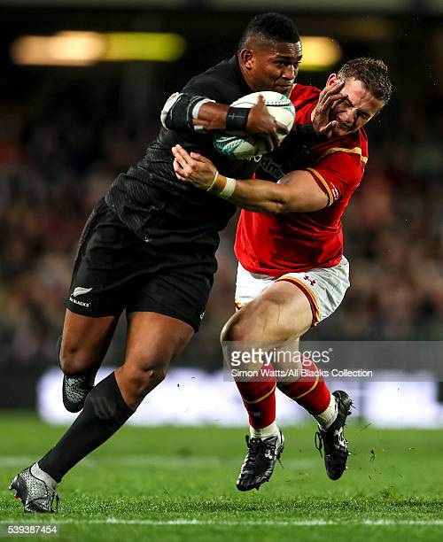 Waisake Naholo of the All Blacks fends the tackle of Hallam Amos of Wales during the International Test match between the New Zealand All Blacks and...