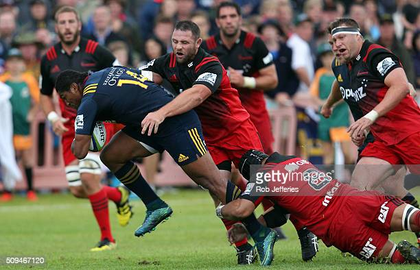 Waisake Naholo of the Highlanders attempts to bust multiple tackles during the Super Rugby trial match between the Highlanders and the Crusaders at...