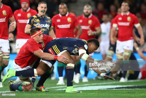 Waisake Naholo of the Highlanders barges through CJ Stander of the Lions to score the opening try during the 2017 British Irish Lions tour match...