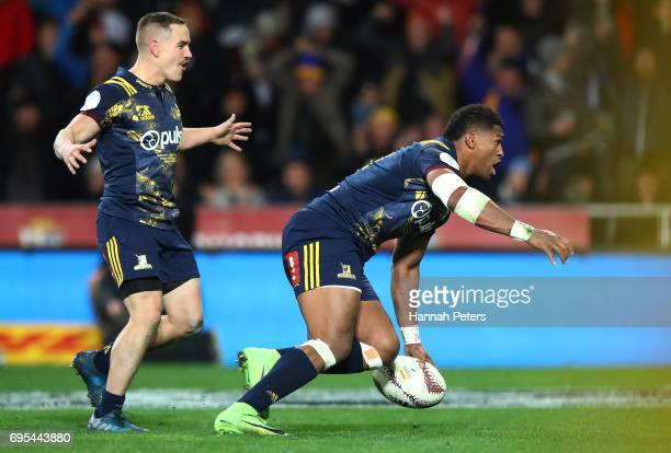 Waisake Naholo of the Highlanders celebrates after scoring the opening try during the 2017 British Irish Lions tour match between the Highlanders and...