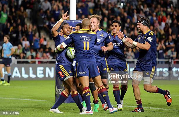 Waisake Naholo of the Highlanders celebrates his try during the round five Super Rugby match between the Highlanders and the Waratahs at Forsyth Barr...