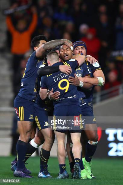 Waisake Naholo of the Highlanders celebrates with teammates after scoring the opening try during the 2017 British Irish Lions tour match between the...