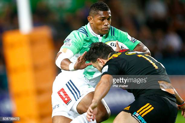 Waisake Naholo of the Highlanders fends off James Lowe of the Chiefs during the round 11 Super Rugby match between the Chiefs and the Highlanders on...