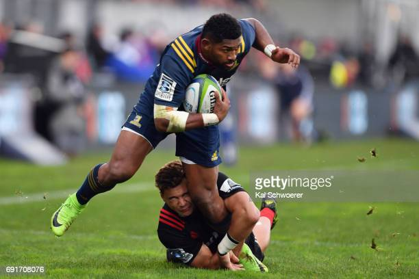 Waisake Naholo of the Highlanders is tackled by David Havili of the Crusaders during the round 15 Super Rugby match between the Crusaders and the...