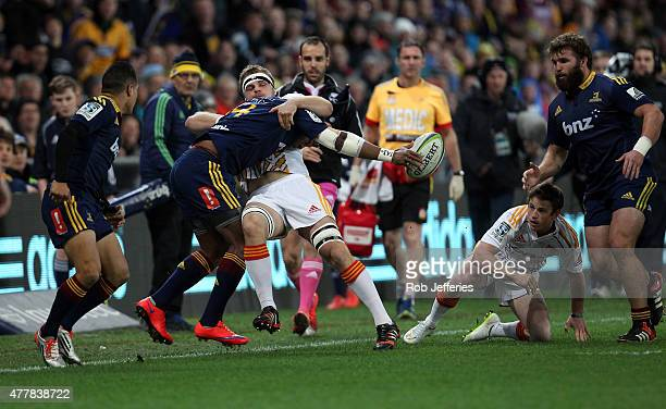 Waisake Naholo of the Highlanders looks to free the ball in the tackle of Sam Cane of the Chiefs during the Super Rugby Qualifying Final match...