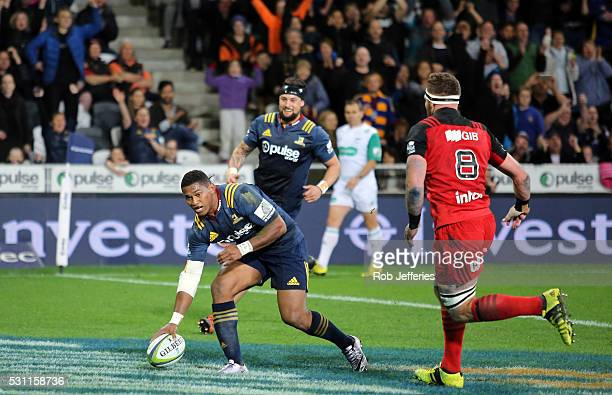 Waisake Naholo of the Highlanders scores a try during the round twelve Super Rugby match between the Highlanders and the Crusaders at Forsyth Barr...