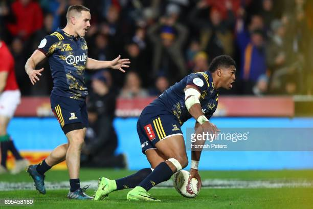 Waisake Naholo of the Highlanders scores the opening try during the 2017 British Irish Lions tour match between the Highlanders and the British Irish...