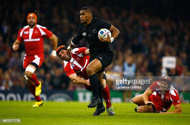 Waisake Naholo of the New Zealand All Blacks breaks to score the opening try during the 2015 Rugby World Cup Pool C match between New Zealand and...