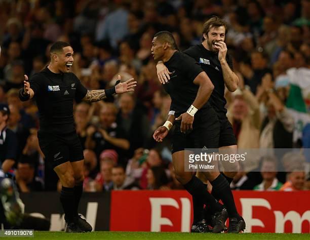 Waisake Naholo of the New Zealand All Blacks celebrates scoring the opening try with Conrad Smith and Aaron Smith of the New Zealand All Blacks...