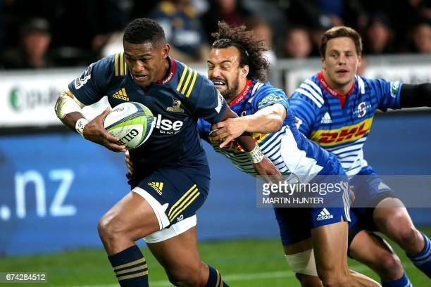 Waisake Naholo of the Otago Highlanders breaks through the tackle of SP Marais of the Western Stormers to score a try during the Super Rugby match...