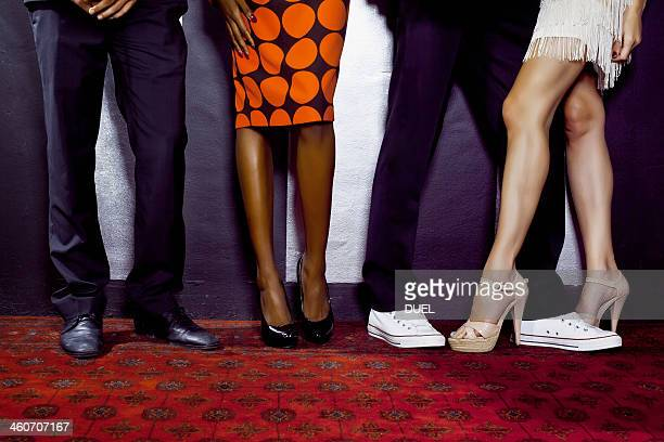 Waist down shot of two couples