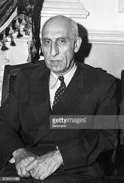 Waistup photo shows Iranian Premier Mohommed Mossadegh seated Ca 1951