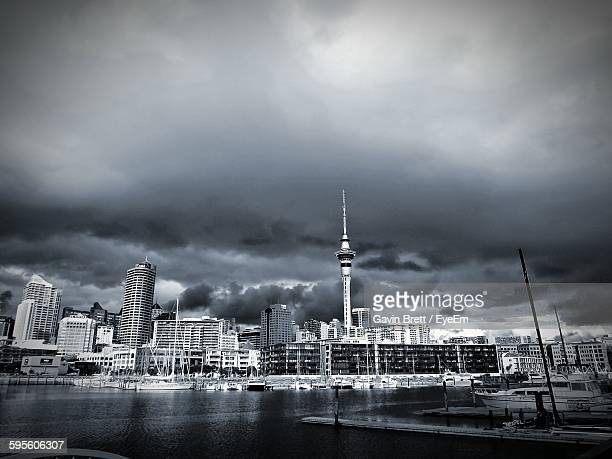 Waitemata Harbor And Buildings Against Cloudy Sky
