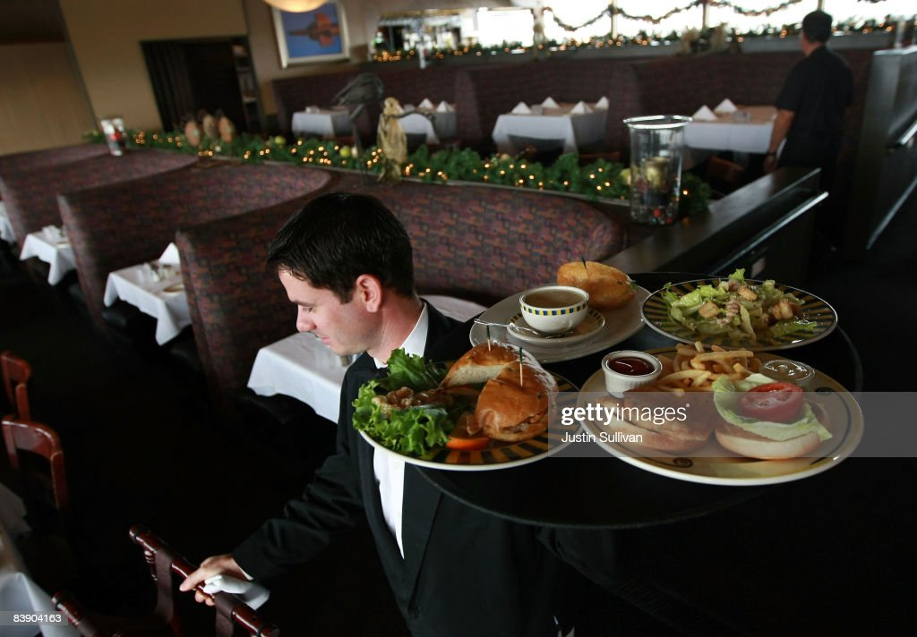 Waiter Alexander Alioto prepares to serve lunch to customers at Alioto's Seafood Restaurant December 3, 2008 in San Francisco, California. A report by The Institute for Supply Management says that its services sector index dropped in November to 37.3, down from 44.4 in October as the service industry struggles through the weak economy.