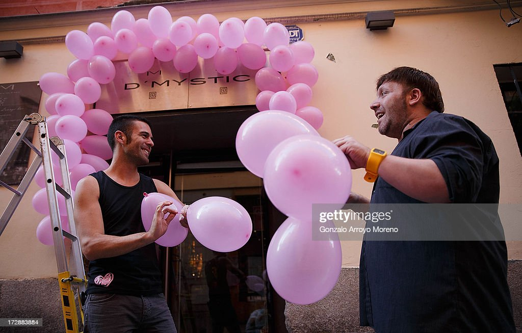 A waiter (L) and a manager (R) of a gay bar decorate the front with pink balloons in Chueca neigborhood during the Madrid Gay Pride Festival 2013 on July 4, 2013 in Madrid, Spain. According to a new Pew Research Center survey about homosexual acceptance across the World, Spain is the top of gay friendly countries with an 88 percent acceptance.