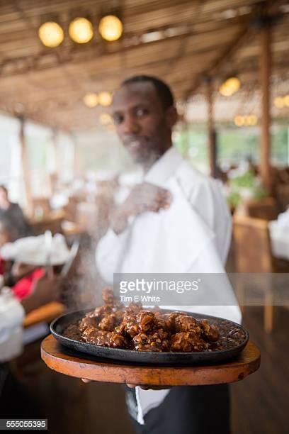 Waiter and food, restaurant, Kigali, Rwanda