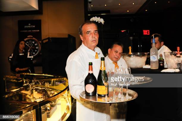 Waiter appears with Veuve Clicquot during the cocktail reception at Vagu on December 7 2017 in Miami Florida