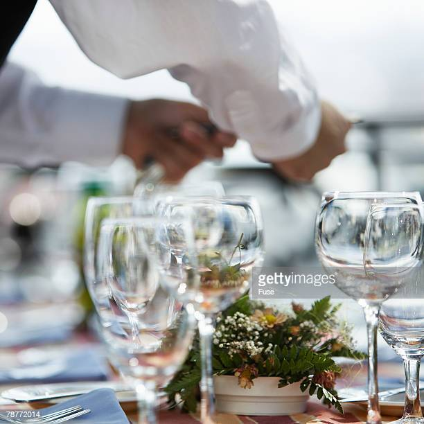 Waiter Arranging Dining Table