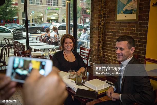 A waiter at Jyoti restaurant takes a picture of Anthony Lacey and Meredith Denbow following their meal at the Adams Morgan restaurant in Washington...