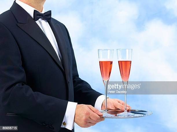 Waiter, Butler with two glasses of pink champagne.