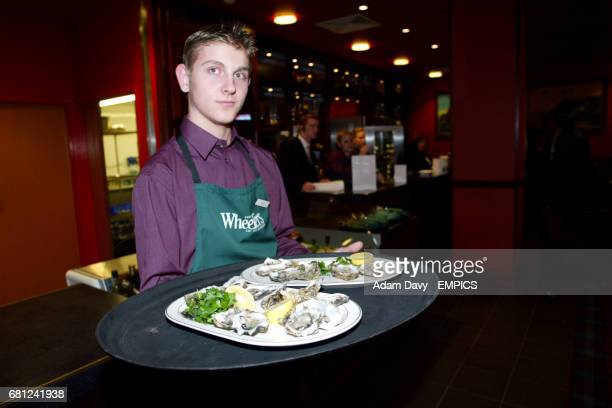 A waiter carries out oysters