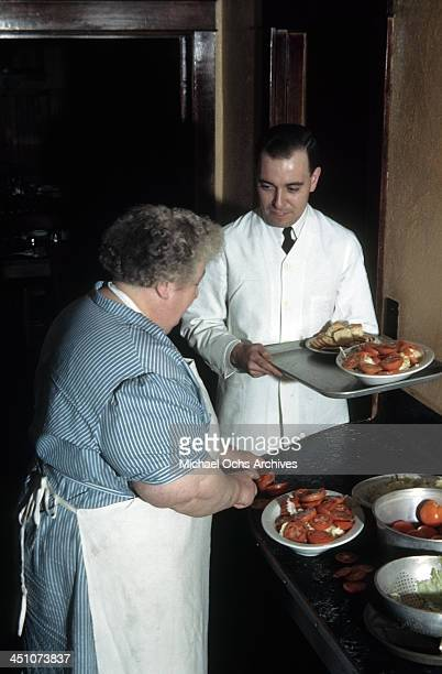 A waiter carries trays of food in the kitchen at The Plaza Hotel in New York New York
