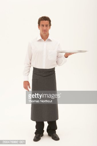 Waiter carrying serving tray, portrait