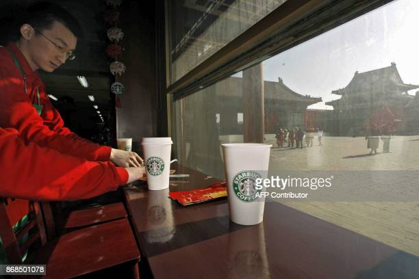 A waiter cleans up at the Starbucks coffee shop in Beijing's Forbidden City 18 January 2007 An online campaign to exile the US coffee giant from the...