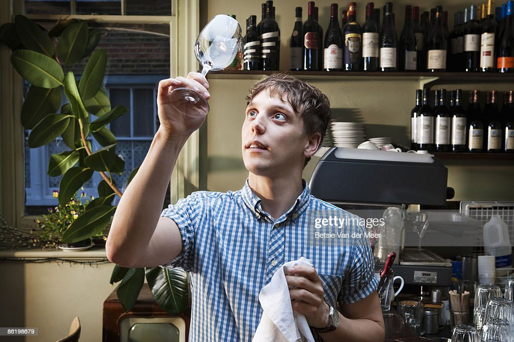 Waiter cleans wineglass. : Stock Photo