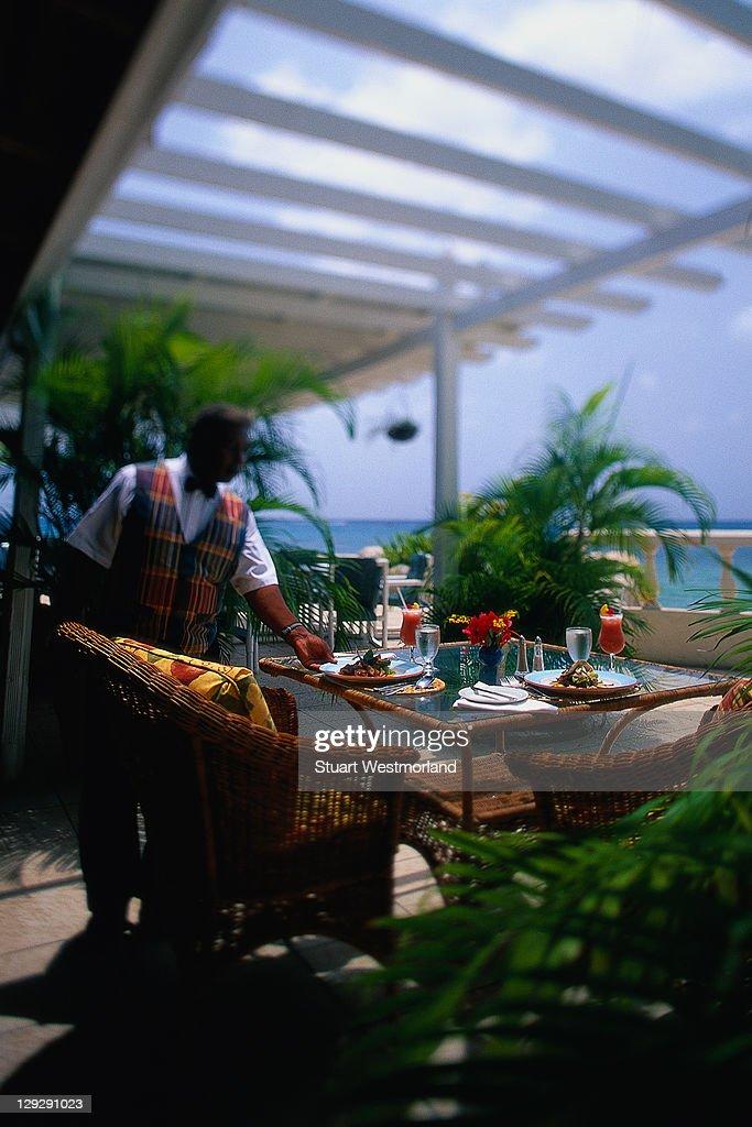 waiter, coral reef club, st thomas, barbados : Stock Photo