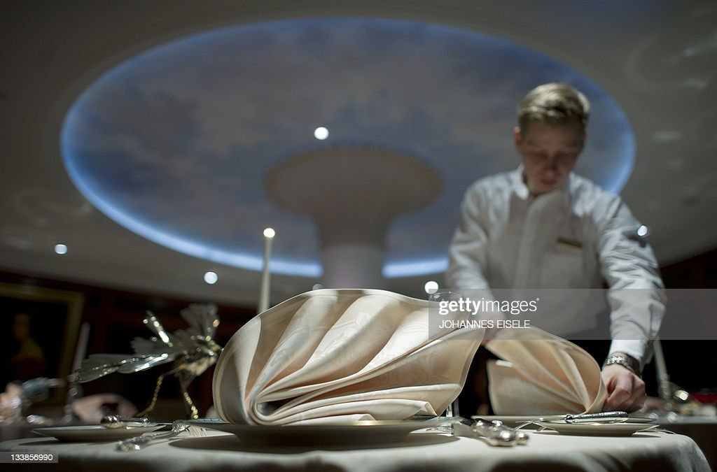 A Waiter Decorates A Table At The Lorenz Adlon Esszimmer Restaurant On  November 17 2011 In
