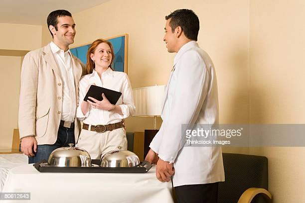 Waiter delivering room service