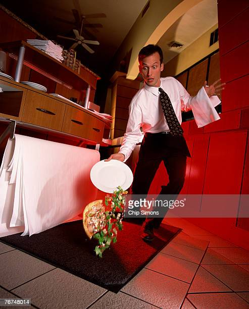 Waiter dropping plate of food