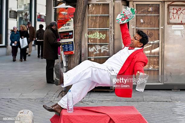 Waiter falling street performer