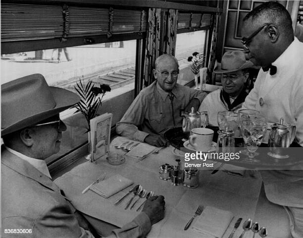 Waiter FW Murray 2420 Franklin St serves coffee to Russell Black foreground Morton Salt Co and Clarence Werthan left rear president of AAA Auto Club...