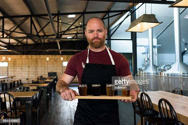 Waiter Holding A Tray Of Beer Tasting Glasses