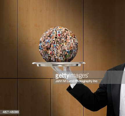 Waiter holding globe collage of business people's faces