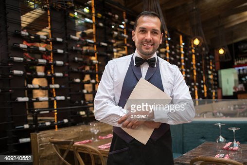 Waiter holding menu at a restaurant