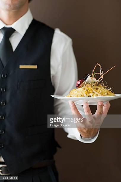 Waiter holding plate