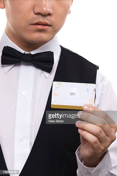Waiter holding VIP card