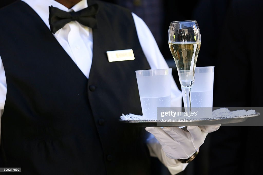 A waiter holds a glass of champing for Rex, King of Carnival, Michael W. Kearney, before his toast during Mardi Gras day on February 9, 2016 in New Orleans, Louisiana. Fat Tuesday, or Mardi Gras in French, is a celebration traditionally held before the observance of Ash Wednesday and the beginning of the Christian Lenten season.