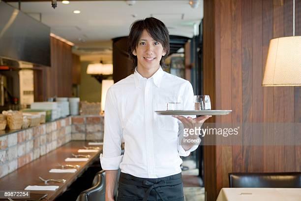 Waiter in restaurant, portrait