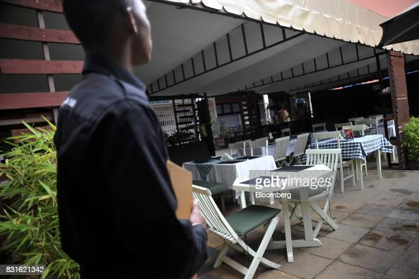 A waiter looks at an empty restaurant terrace while waiting for customers in Nairobi Kenya on Tuesday Aug 15 2017 Kenyan opposition leader Raila...