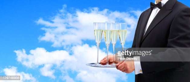 Waiter offering champagne at open air party : ストックフォト