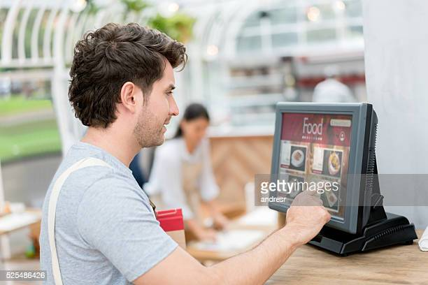 Waiter placing an order in the computer