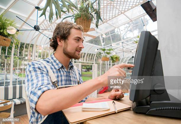Waiter placing an order on the computer