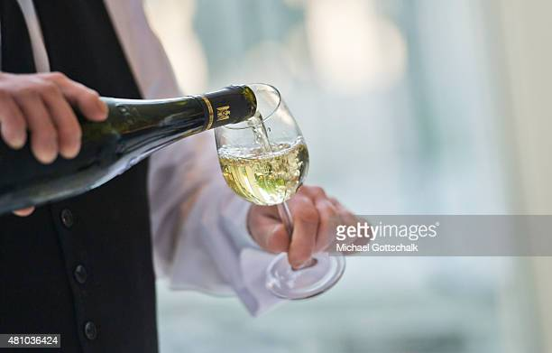 A Waiter pours a glass of white wine on July 05 2015 in Mainz Germany